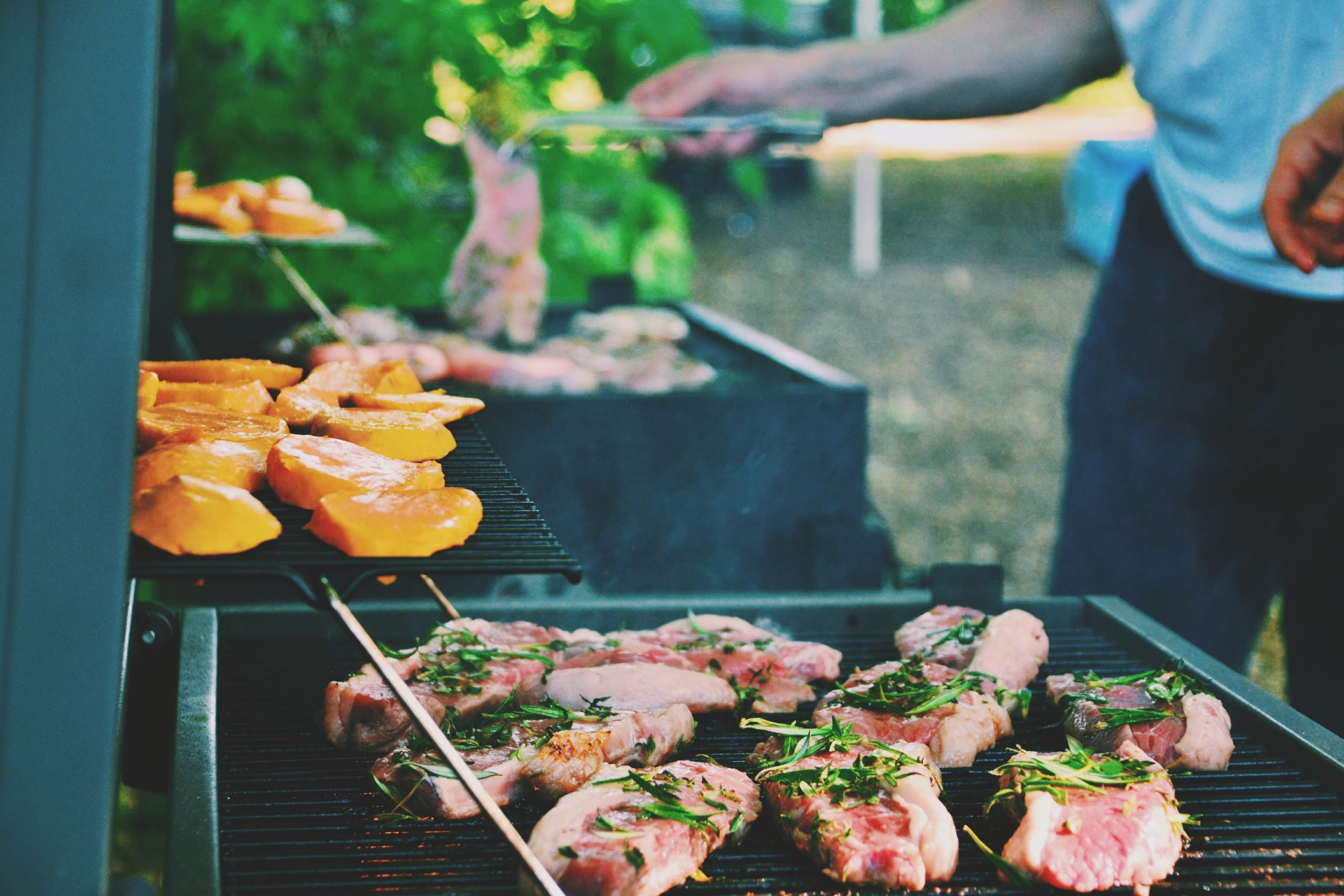 Marinated meat cooking on a gas barbecue grill